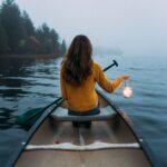 Woman holding lantern by Aaron Weiss on Unsplash