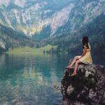 Woman sitting on rock by Nadi Whatisdelirium on Unsplash